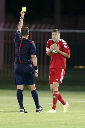 igor: BUDAPEST, HUNGARY - AUGUST 1, 2014: Igor Morozov of DVSC collects a yellow card during MTK Budapest vs. DVSC OTP Bank League football match at Bozsik Stadium on August 1, 2014 in Budapest, Hungary.