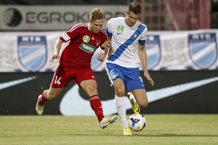 barnabas: BUDAPEST, HUNGARY - AUGUST 1, 2014: Duel between Barnabas Bese of MTK (r) and Daniel Vadnai of DVSC during MTK Budapest vs. DVSC OTP Bank League football match at Bozsik Stadium on August 1, 2014 in Budapest, Hungary.