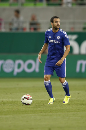 cesc: BUDAPEST, HUNGARY - AUGUST 10, 2014: Cesc Fabregas of Chelsea during Ferencvaros vs. Chelsea stadium opening football match at Groupama Arena on August 10, 2014 in Budapest, Hungary.