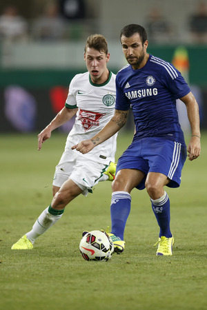 BUDAPEST, HUNGARY - AUGUST 10, 2014: Cesc Fabregas (r) of Chelsea during Ferencvaros vs. Chelsea stadium opening football match at Groupama Arena on August 10, 2014 in Budapest, Hungary.
