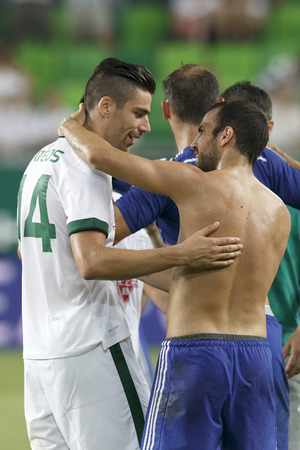 BUDAPEST, HUNGARY - AUGUST 10, 2014: David Mateos of FTC (l) and Cesc Fabregas of Chelsea during Ferencvaros vs. Chelsea stadium opening football match at Groupama Arena on August 10, 2014 in Budapest, Hungary.  Editorial