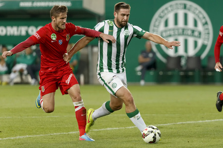 bode: BUDAPEST, HUNGARY - AUGUST 27, 2014: Duel between Daniel Bode of FTC (r) and Dino Gavric of Dunaujvaros during Ferencvaros vs. Dunaujvaros OTP Bank League football match at Groupama Arena on August 27, 2014 in Budapest, Hungary.