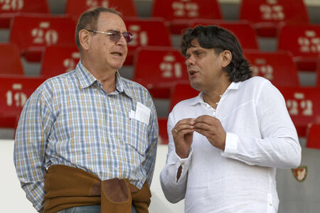 hemingway: BUDAPEST, HUNGARY - AUGUST 31, 2014: Tamas Deutsch (r), president of MTK and Representative of FIDESZ at the European Parliament and George F. Hemingway, president of football club Honved during MTK vs. Ferencvaros OTP Bank League football match at Bozsik