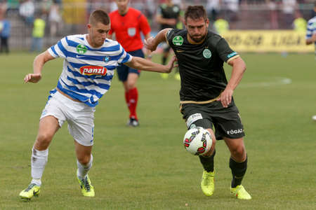 bode: BUDAPEST, HUNGARY - AUGUST 31, 2014: Duel between David Kelemen of MTK (l) and Daniel Bode of FTC during MTK vs. Ferencvaros OTP Bank League football match at Bozsik Stadium on August 31, 2014 in Budapest, Hungary.