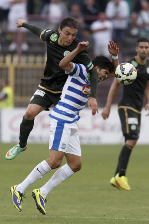 sergio: BUDAPEST, HUNGARY - AUGUST 31, 2014: Air battle between Sergio Fernandez Tamayo of MTK (r) and Vladan Cukic of FTC during MTK vs. Ferencvaros OTP Bank League football match at Bozsik Stadium on August 31, 2014 in Budapest, Hungary.