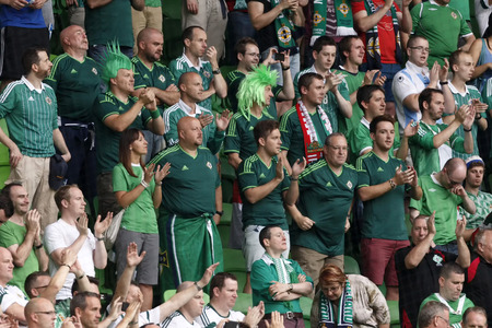 BUDAPEST, HUNGARY - SEPTEMBER 7, 2014: Northern Irish fans celebrate during Hungary vs. Northern Ireland UEFA Euro 2016 qualifier football match at Groupama Arena on September 7, 2014 in Budapest, Hungary.