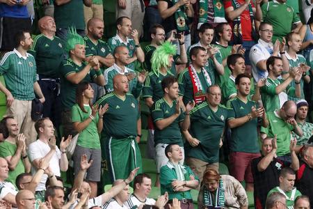 BUDAPEST, HUNGARY - SEPTEMBER 7, 2014: Northern Irish fans celebrate during Hungary vs. Northern Ireland UEFA Euro 2016 qualifier football match at Groupama Arena on September 7, 2014 in Budapest, Hungary.