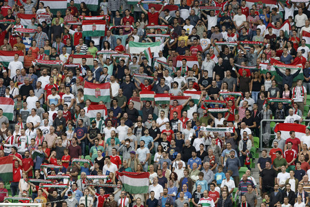 BUDAPEST, HUNGARY - SEPTEMBER 7, 2014: Hungarian fans listen to their national anthem during Hungary vs. Northern Ireland UEFA Euro 2016 qualifier football match at Groupama Arena on September 7, 2014 in Budapest, Hungary.