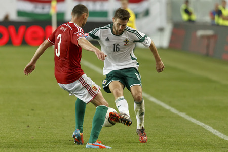 BUDAPEST, HUNGARY - SEPTEMBER 7, 2014: Duel between Hunagrian Vilmos Vanczak (l) and Northern Irish Oliver Norwood during Hungary vs. Northern Ireland UEFA Euro 2016 qualifier football match at Groupama Arena on September 7, 2014 in Budapest, Hungary.