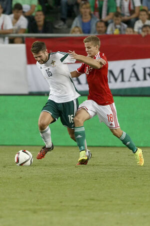 BUDAPEST, HUNGARY - SEPTEMBER 7, 2014:Duel between  Hunagrian Istvan Kovacs (l) and Northern Irish Oliver Norwood during Hungary vs. Northern Ireland UEFA Euro 2016 qualifier football match at Groupama Arena on September 7, 2014 in Budapest, Hungary.