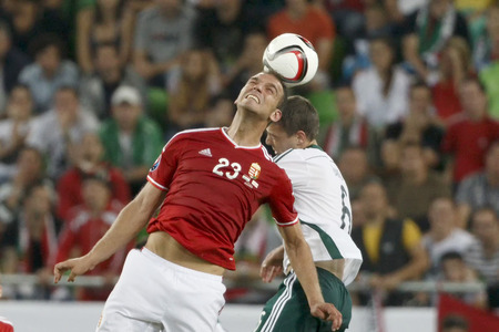 BUDAPEST, HUNGARY - SEPTEMBER 7, 2014: Air battle between Hunagrian Roland Juhasz (l) and Northern Irish Chris Baird during Hungary vs. Northern Ireland UEFA Euro 2016 qualifier football match at Groupama Arena on September 7, 2014 in Budapest, Hungary.