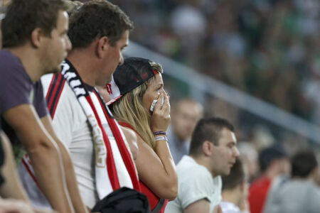 BUDAPEST, HUNGARY - SEPTEMBER 7, 2014: Disappointed Hungarian fan cries during Hungary vs. Northern Ireland UEFA Euro 2016 qualifier football match at Groupama Arena on September 7, 2014 in Budapest, Hungary.