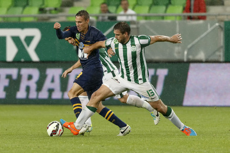 BUDAPEST, HUNGARY - SEPTEMBER 14, 2014: Daniel Bode of FTC (r) tries to pull back Mate Papp of Puskas during Ferencvaros vs. Puskas Akademia OTP Bank League football match at Groupama Arena on September 14, 2014 in Budapest, Hungary.