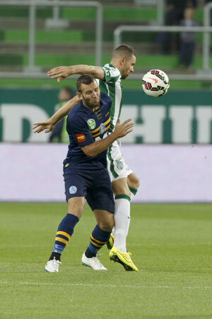 BUDAPEST, HUNGARY - SEPTEMBER 14, 2014: Attila Busai of FTC (r) covers the ball from Zoltan Szelesi of Puskas during Ferencvaros vs. Puskas Akademia OTP Bank League football match at Groupama Arena on September 14, 2014 in Budapest, Hungary.