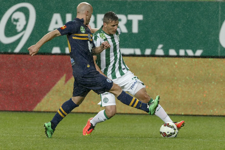 BUDAPEST, HUNGARY - SEPTEMBER 14, 2014: Duel between Stjepan Kukurozovic of FTC (r) and Balazs Toth of Puskas during Ferencvaros vs. Puskas Akademia OTP Bank League football match at Groupama Arena on September 14, 2014 in Budapest, Hungary.