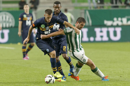 BUDAPEST, HUNGARY - SEPTEMBER 14, 2014: Duel between Daniel Bode of FTC (r) and Mark Tamas of Puskas during Ferencvaros vs. Puskas Akademia OTP Bank League football match at Groupama Arena on September 14, 2014 in Budapest, Hungary.