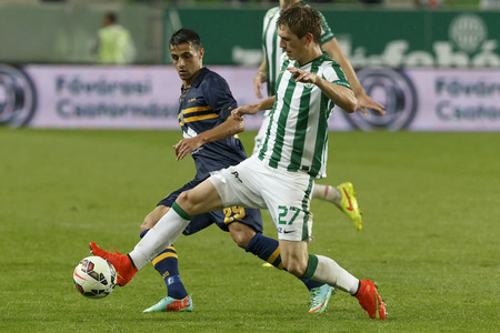 puskas: BUDAPEST, HUNGARY - SEPTEMBER 14, 2014: Michal Nalepa of FTC (r) is followed by Laszlo Lencse of Puskas during Ferencvaros vs. Puskas Akademia OTP Bank League football match at Groupama Arena on September 14, 2014 in Budapest, Hungary.