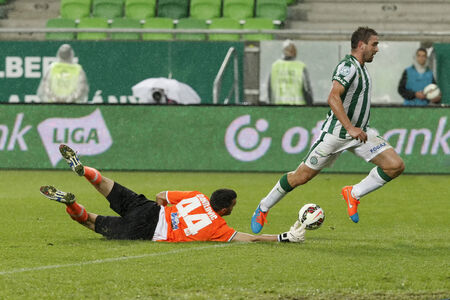 BUDAPEST, HUNGARY - SEPTEMBER 14, 2014: Daniel Bode of FTC (r) is tackled by Branislav Danilovic of Puskas during Ferencvaros vs. Puskas Akademia OTP Bank League football match at Groupama Arena on September 14, 2014 in Budapest, Hungary.  Editorial