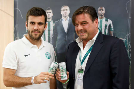 pal: BUDAPEST, HUNGARY - OCTOBER 18, 2014: CEO of FTC, Pal Orosz (r) and football player Gabor Gyomber present the new energy drink of Ferencvaros at Groupama Arena on October 18, 2014 in Budapest, Hungary.