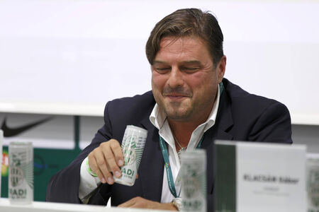 pal: BUDAPEST, HUNGARY - OCTOBER 18, 2014: CEO of FTC, Pal Orosz presents and tastes the new energy drink of Ferencvaros at Groupama Arena on October 18, 2014 in Budapest, Hungary.