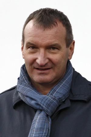 match head: BUDAPEST, HUNGARY - NOVEMBER 2, 2014: Head coach of Lithuanian national team, Csaba Laszlo during MTK vs. Ujpest OTP Bank League football match at Bozsik Stadium on November 2, 2014 in Budapest, Hungary.