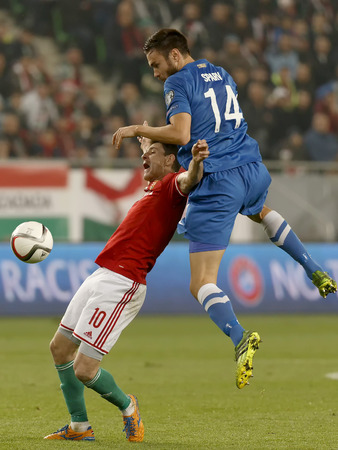BUDAPEST, HUNGARY - NOVEMBER 14, 2014: Air battle between Hunagrian Zoltan Gera (l) and Finnish Tim Sparv during Hungary vs. Finland UEFA Euro 2016 qualifier football match in Groupama Arena on November 14, 2014 in Budapest, Hungary.