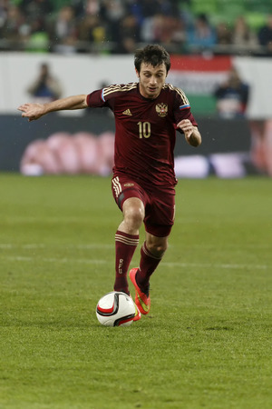 alan: BUDAPEST, HUNGARY - NOVEMBER 18, 2014: Russian Alan Dzagoev is with the ball during Hungary vs. Russia friendly football match in Groupama Arena on November 18, 2014 in Budapest, Hungary.