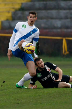 barnabas: BUDAPEST, HUNGARY - NOVEMBER 22, 2014: Barnabas Bese of MTK (l) is watched by Senad Husic of DVTK during MTK Budapest vs. DVTK OTP Bank League football match in Bozsik Stadium on November 22, 2014 in Budapest, Hungary.