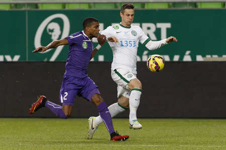 BUDAPEST, HUNGARY - DECEMBER 2, 2014: Philipp Bonig of Ferencvaros (r) runs next to Loic Nego of Ujpest during Ferencvaros vs. Ujpest League Cup football match in Groupama Arena on December 2, 2014 in Budapest, Hungary. Stock fotó - 34288776