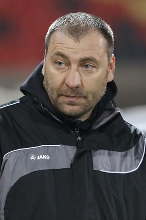 match head: BUDAPEST, HUNGARY - FEBRUARY 27, 2015: Head coach of Paks, Aurel Csertoi during MTK vs. Paksi FC OTP Bank League football match in Bozsik Stadium.