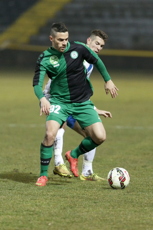 barnabas: BUDAPEST, HUNGARY - FEBRUARY 27, 2015: Barnabas Bese of MTK (r) tries to tackle Zsolt Balazs of Paks during MTK vs. Paksi FC OTP Bank League football match in Bozsik Stadium. Editorial