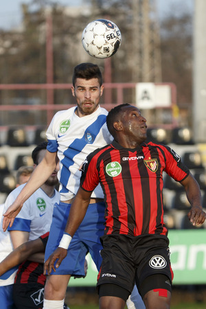 teammate: BUDAPEST, HUNGARY - MARCH 8, 2015: Air battle between Souleymane Youla of Honved (r) and Tibor Nagy of MTK during Honved vs. MTK OTP Bank League football match in Bozsik Stadium. Editorial