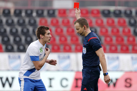 offside: BUDAPEST, HUNGARY - MARCH 14, 2015: Zsolt Poloskei of MTK (l) uncomprehends before referee Tamas Bognar during MTK vs. Videoton OTP Bank League football match in Bozsik Stadium. Editorial