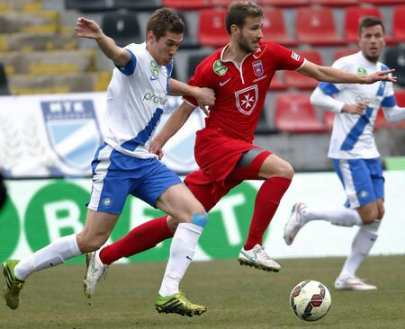 teammate: BUDAPEST, HUNGARY - MARCH 14, 2015: Zsolt Poloskei of MTK (l) runs after Dinko Trebotic of Videoton during MTK vs. Videoton OTP Bank League football match in Bozsik Stadium. Editorial