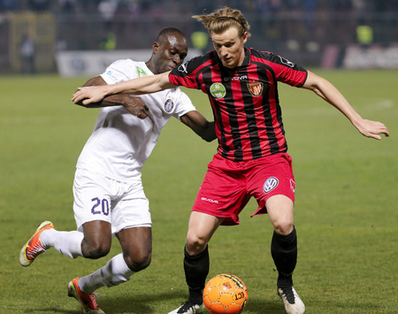 patrik: BUDAPEST, HUNGARY - MARCH 21, 2015: Patrik Hidi of Honved (r) is tackled by Aaron Addo of Ujpest during Honved vs. Ujpest OTP Bank League football match in Bozsik Stadium. Editorial