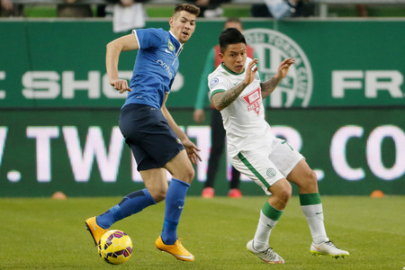 barnabas: BUDAPEST, HUNGARY - MARCH 22, 2015: Cristian Ramirez of Ferencvaros (r) and Barnabas Bese of MTK wacth the ball during Ferencvaros vs. MTK OTP Bank League football match in Groupama Arena.