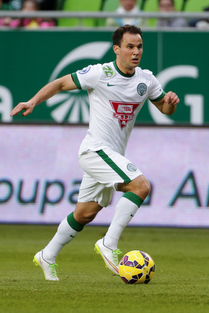 BUDAPEST, HUNGARY - MARCH 22, 2015: Tamas Hajnal of Ferencvaros is with the ball during Ferencvaros vs. MTK OTP Bank League football match in Groupama Arena.