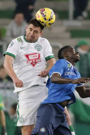 bode: BUDAPEST, HUNGARY - MARCH 22, 2015: Air battle between Daniel Bode of Ferencvaros (l) and Thiam Khaly Iyane of MTK during Ferencvaros vs. MTK OTP Bank League football match in Groupama Arena.
