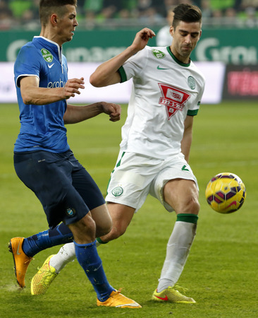 barnabas: BUDAPEST, HUNGARY - MARCH 22, 2015: Duel between Michal Nalepa of Ferencvaros (r) and Barnabas Bese of MTK during Ferencvaros vs. MTK OTP Bank League football match in Groupama Arena. Editorial