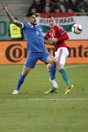 BUDAPEST, HUNGARY - MARCH 29, 2015: Duel between Hungarian Daniel Tozser (r) and Greek Panagiotis Kone during Hungary vs. Greece UEFA Euro 2016 qualifier football match in Groupama Arena.