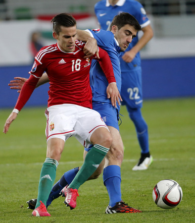 qualifier: BUDAPEST, HUNGARY - MARCH 29, 2015: Hungarian Zoltan Stieber (l) is tackled by Greek Sokratis Papastathopoulos during Hungary vs. Greece UEFA Euro 2016 qualifier football match in Groupama Arena.