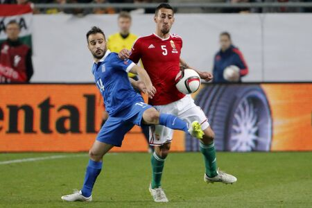 uefa: BUDAPEST, HUNGARY - MARCH 29, 2015: Duel between Hungarian Leandro (r) and Greek Giannis Fetfatzidis during Hungary vs. Greece UEFA Euro 2016 qualifier football match in Groupama Arena.
