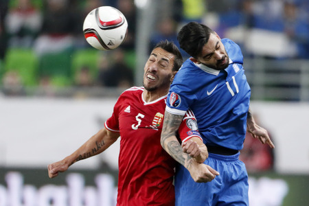 qualifier: BUDAPEST, HUNGARY - MARCH 29, 2015: Air battle between Hungarian Leandro (l) and Greek Giannis Gianniotas during Hungary vs. Greece UEFA Euro 2016 qualifier football match in Groupama Arena.