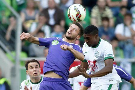 BUDAPEST, HUNGARY - APRIL 12, 2015: Air battle between Somalia of Ferencvaros (r) and Asmir Suljic of Ujpest is watched by Tamas Hajnal (l) during Ferencvaros vs. Ujpest OTP Bank League football match in Groupama Arena. Sajtókép