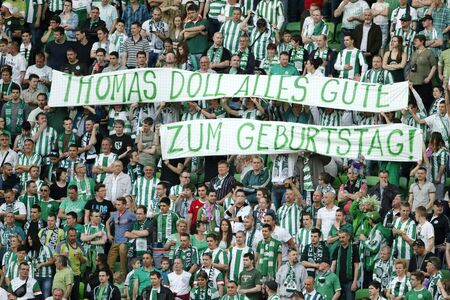 match head: BUDAPEST, HUNGARY - APRIL 12, 2015: The fans of Ferencvaros wish happy birthday to the head coach, Thomas Doll during Ferencvaros vs. Ujpest OTP Bank League football match in Groupama Arena. Editorial