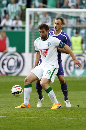 offside: BUDAPEST, HUNGARY - APRIL 12, 2015: Daniel Bode of Ferencvaros (l) covers the ball from Robert Litauszki of Ujpest during Ferencvaros vs. Ujpest OTP Bank League football match in Groupama Arena.