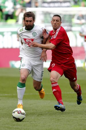 bode: BUDAPEST, HUNGARY - MAY 10, 2015: Duel between Daniel Bode of Ferencvaros (l) and Norbert Meszaros of DVSC during Ferencvaros vs. DVSC OTP Bank League football match in Groupama Arena. Editorial