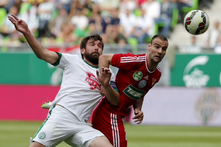 bode: BUDAPEST, HUNGARY - MAY 10, 2015: Duel between Daniel Bode of Ferencvaros (l) and Dusan Brkovic of DVSC during Ferencvaros vs. DVSC OTP Bank League football match in Groupama Arena. Editorial
