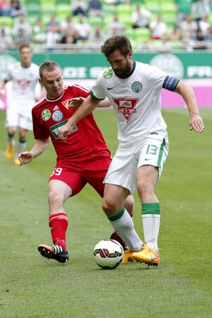 bode: BUDAPEST, HUNGARY - MAY 10, 2015: Duel between Daniel Bode of Ferencvaros (r) and Mihaly Korhut of DVSC during Ferencvaros vs. DVSC OTP Bank League football match in Groupama Arena.