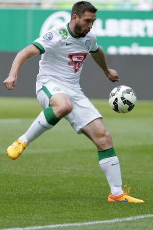 teammate: BUDAPEST, HUNGARY - MAY 30, 2015: Daniel Bode of Ferencvaros shoots on goal during Ferencvaros vs. Videoton OTP Bank League football match in Groupama Arena.